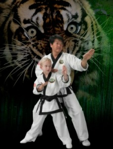 Grand Master T.H. Kim with a student